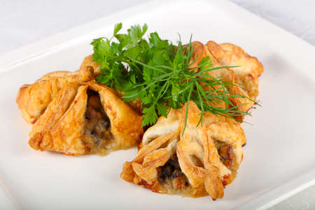 Pastry with meat served parsley Standard-Bild