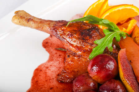 Duck leg with grape, orange and pear