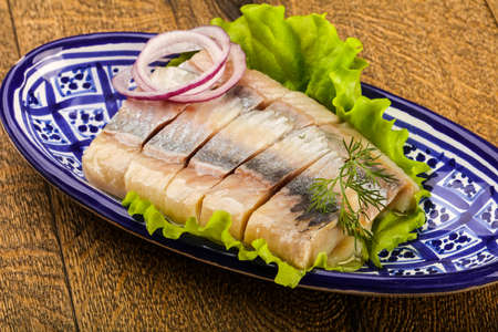 Sliced Herring fillet with dill and onion Foto de archivo