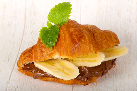 Croissant with chocolate and banana served leaves Stok Fotoğraf