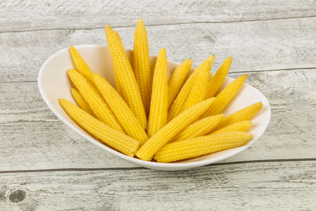Pickled baby corn in the bowl Banco de Imagens