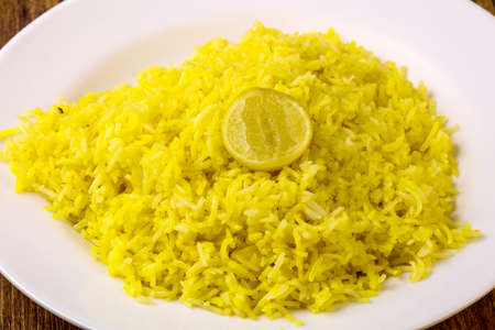Indian traditional cuisine - Yellow rice with lime Stock Photo