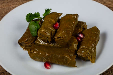 Caucasian traditional Dolma - minced meat in grape leaves Imagens