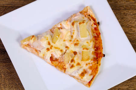 Pineapple pizza with soft cheese Stock Photo