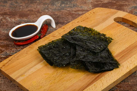 Tasty Nori chips with soya sauce Фото со стока