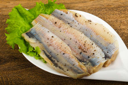 Herring fillet with pepper Фото со стока
