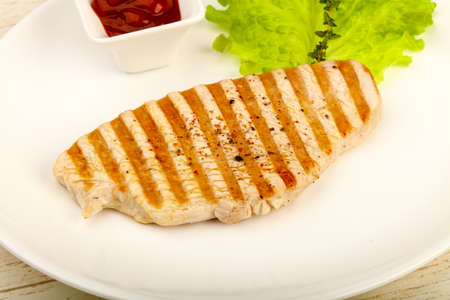 Grilled turkey steak with spices and sauce