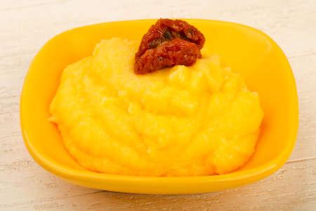 Polenta with dry tomato Reklamní fotografie