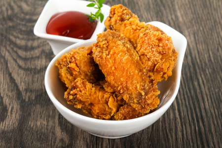 Crispy chicken wings with  ketchup