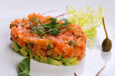 Tartar with salmon and avocado served capers and balsamico
