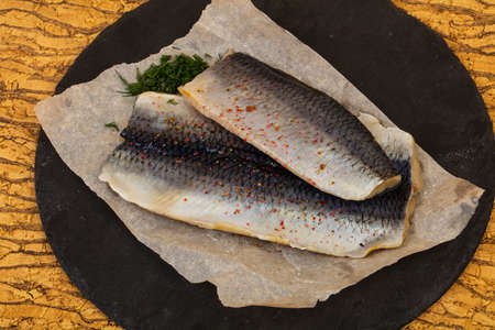 Herring Fillet with skin over the wooden background