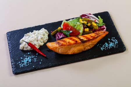 Grilled salmon steak with sauce 版權商用圖片