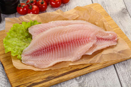 Raw tilapia fish ready for cooking Standard-Bild - 118035463