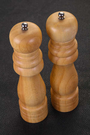 Wooden pepper and salt mill on the table 스톡 콘텐츠