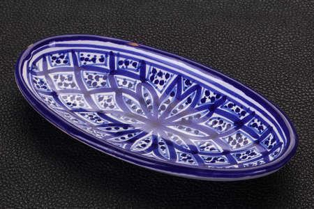 Empty ceramic bowl over black background Stockfoto