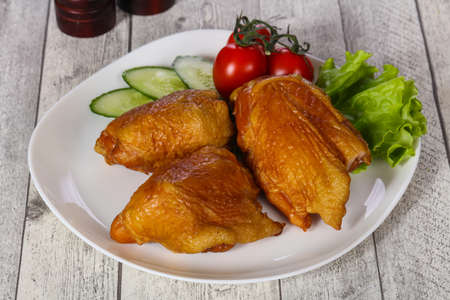 Smoked Chicken hip with salad leaves