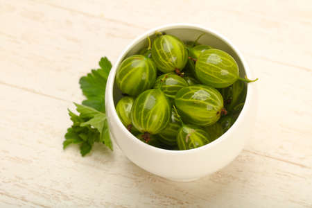 Gooseberries in the bowl with leaf