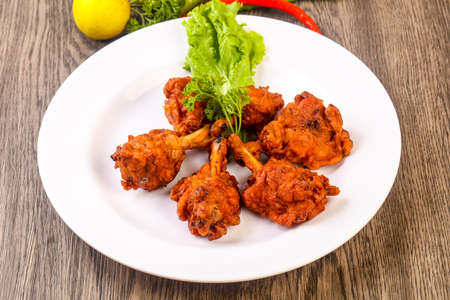 Indian traditional cuisine - Chicken lollipops with spices Banco de Imagens