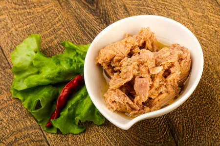 Canned tuna fish in the bowl ready for cooking