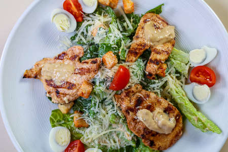 Caesar salad with Grilled chicken Фото со стока