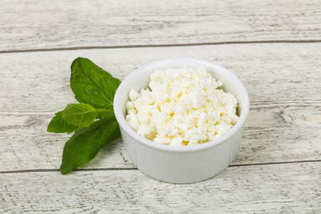 Natural cottage cheese served mint leaves