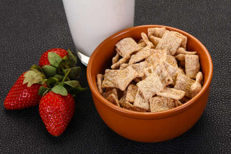 Wheat flakes for breakfast with milk and strawberry Stok Fotoğraf