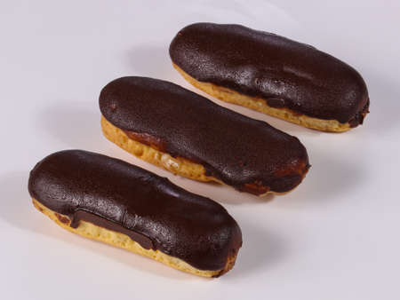 Tasty eclair with cream and chocolate