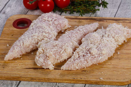 Raw chicken cutlet ready for cooking