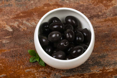 Black olives heap in the bowl