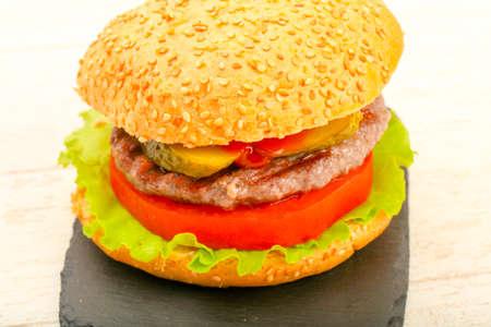 Homemade hamburger with tomato and salad leaves