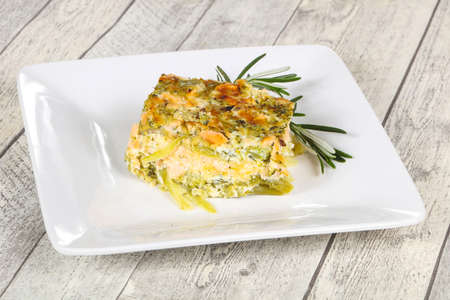 Tasty casserole with salmon and broccoli served rosemary Stock Photo