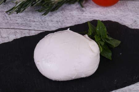 Italian Mozzarella cheese ball served basil and tomatoes Banco de Imagens