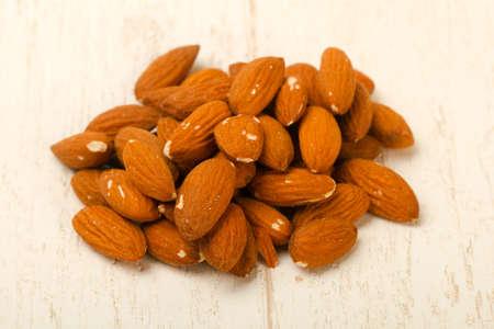 Almond nuts heap Stock Photo - 123854674