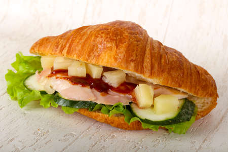 Croissant with chicken and tomato Banco de Imagens