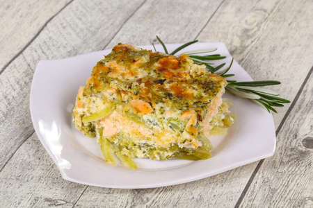 Tasty casserole with salmon and broccoli served rosemary Foto de archivo