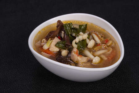 Thai style soup with meat, vegetables and mushrooms Stock Photo