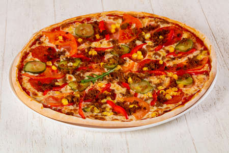 Pizza with minced meat and tomato