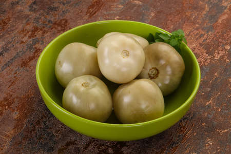 Pickled green tomatoes in the bowl