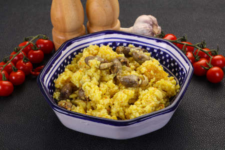 Rice with Chicken hearts and spices Фото со стока