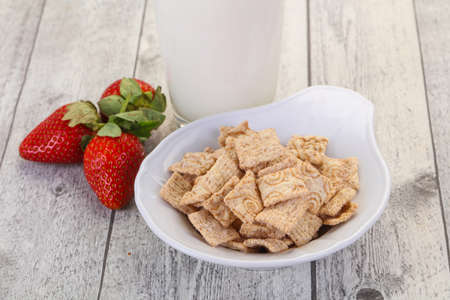 Wheat flakes for breakfast with milk and strawberry Stock Photo