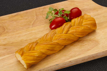 Caucasian traditional pigtail cheese served tomatoes and basil leaves Stock fotó