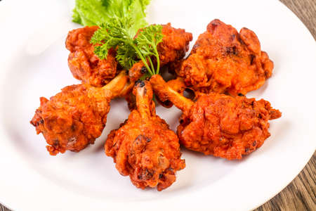 Indian traditional cuisine - Chicken lollipops with spices 版權商用圖片