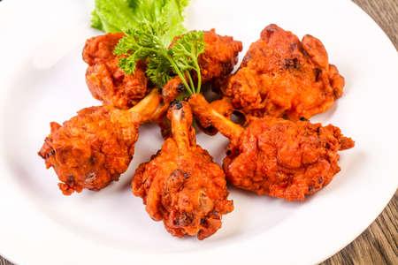 Indische traditionelle Küche - Hühnerlutscher mit Gewürzen