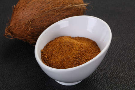 Coconut brown sugar in the bowl over wooden background Stock Photo