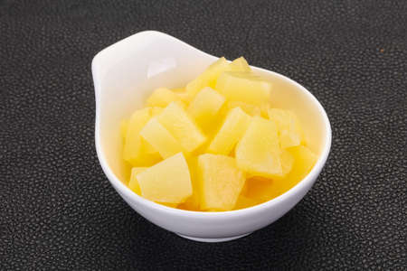 Marinated pineapple pieces in the bowl Banco de Imagens