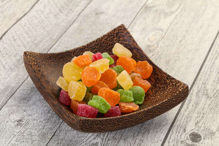 Sweet candied fruit heap in the bowl Imagens
