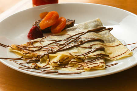 Pancake with chocolate and dried fruits Stock Photo
