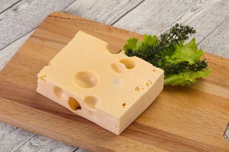 Maasdam cheese brick with thyme branch Banco de Imagens