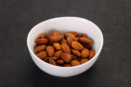 Almonds nuts heap in the bowl