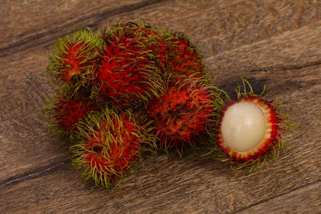Tropical sweet exotic fruit Rambutan heap